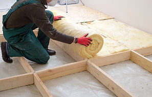 Caucasian Construction Worker with Roll of Insulating Material, Floor Insulating by Minera