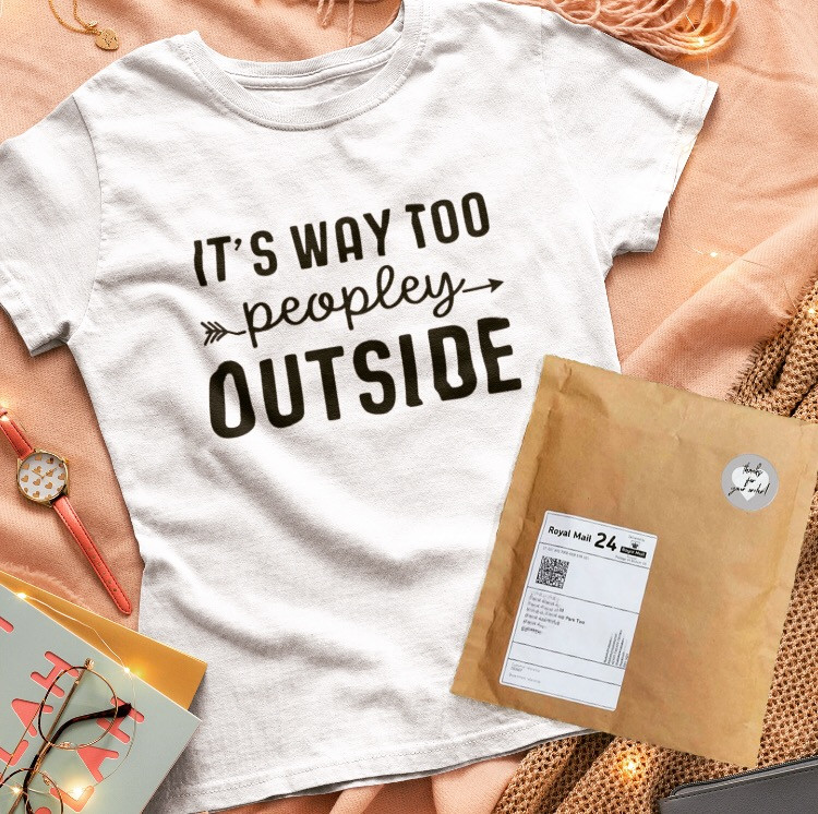 T-Shirt Flat Lay with Paper Packaging Example