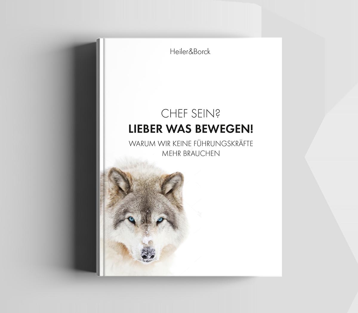 Mock-up des Buchs: Chef sein? Lieber was bewegen! Es zeigt einen Wolf im Winterfell, der den Leser mit blauen Augen anschaut.