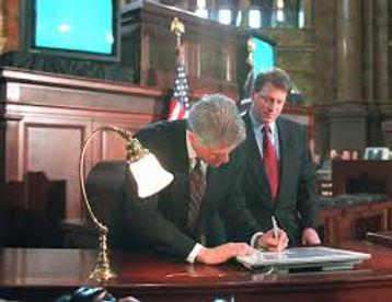 Telecom Act signed.jpg