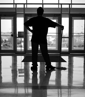 Janitor in black and white