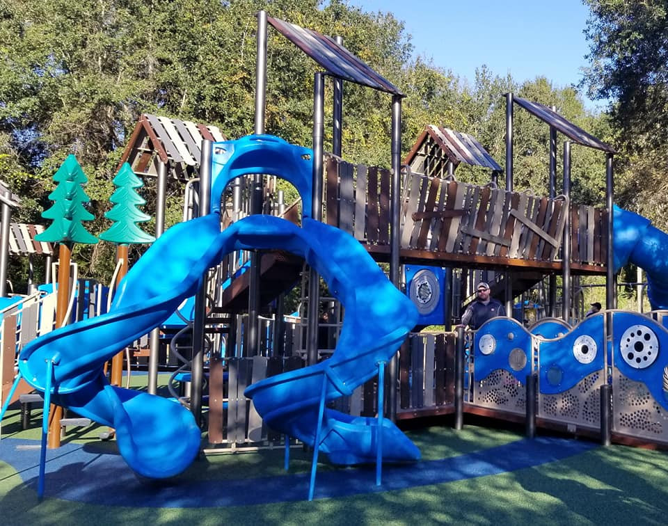 two spiral slides at kid's park, don't fall off the edge!