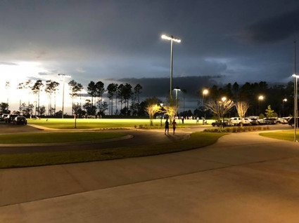 integrity park at night, with group walking