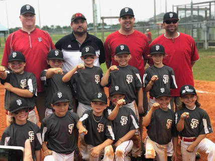 group of young baseball players showing off their championship rings - boys rule