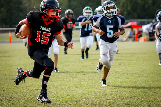 young football player running for a touchdown