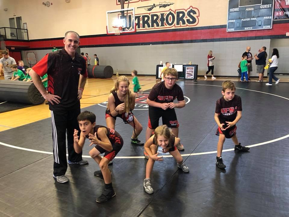 young wrestling team giving their best ready stance for the camera