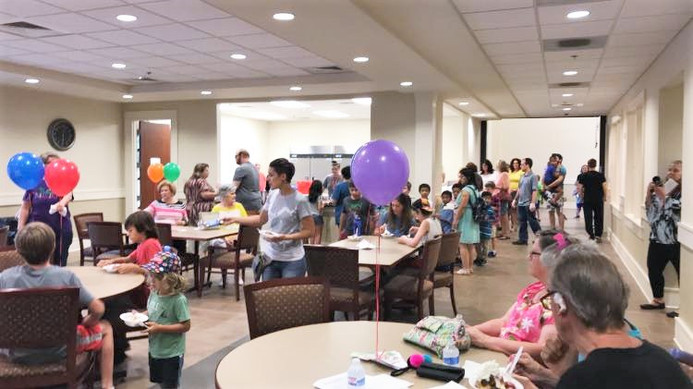 People line up for ice cream at Spanish Fort Public Library's annual Ice cream social, sponsored by Publix