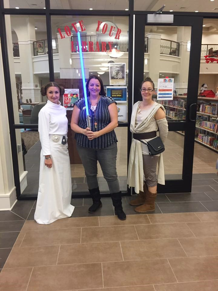 library staff are dressed up for May the 4th