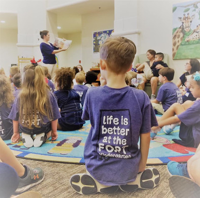 Elementary students come to the Library on a field trip and listen to a good book at story time