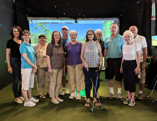 the group on our monthly outing - this time to fairways indoor golf cub - imagine everyone swinging golf clubs at a green screen for an hour