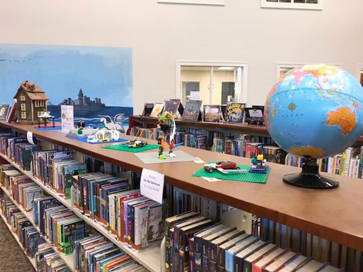 free build legos on top of book shelves in the library