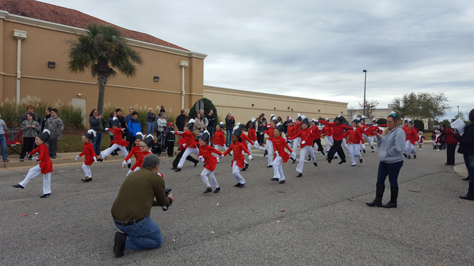 little girls dressed like toy soliders for christmas parade