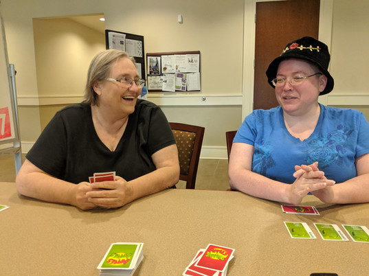 two of our friends playing apples to apples