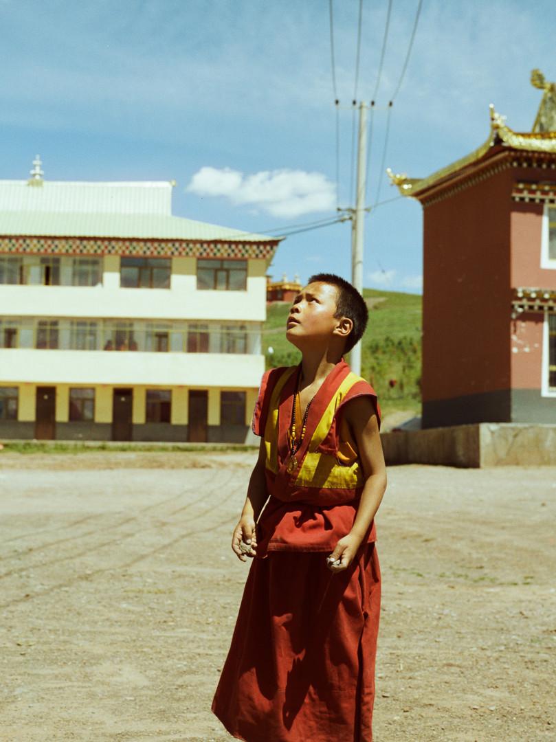 Monk playing basketball