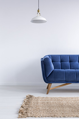Ascetic home interior with blue sofa, ru