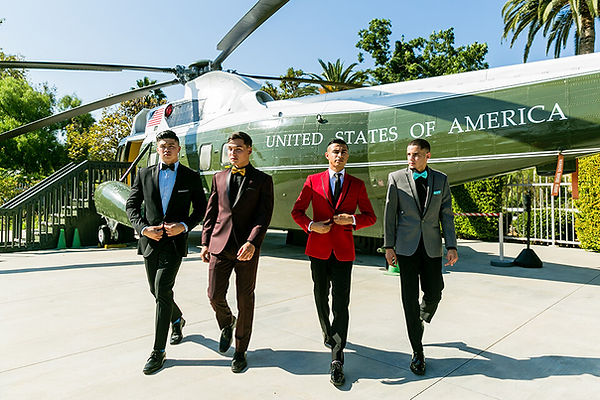 Orange-county-prom-shoot-at-the-richard-nixon-library-guys-walking-by-helicopter-front-vie