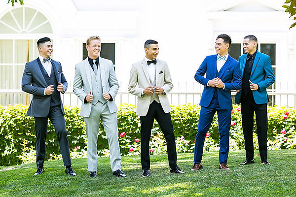 Orange-county-prom-shoot-at-the-richard-nixon-library-guys-standing-on-the-grass-laughing.