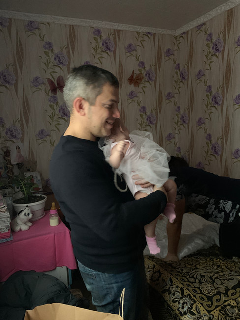 Pastor takes MPI staff to visit single Mom living in 1 room home with no kitchen or bathroom. This Mom has twin baby daughters.