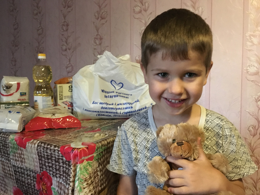 Boy in Stepove receives a prayer bear package and his family gets much needed food