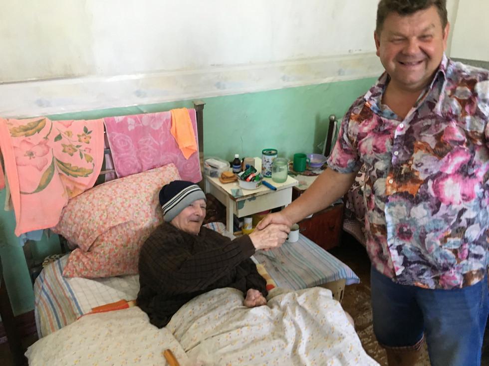 Pastor Sergei visits lonely bedridden senior in Senior's Home