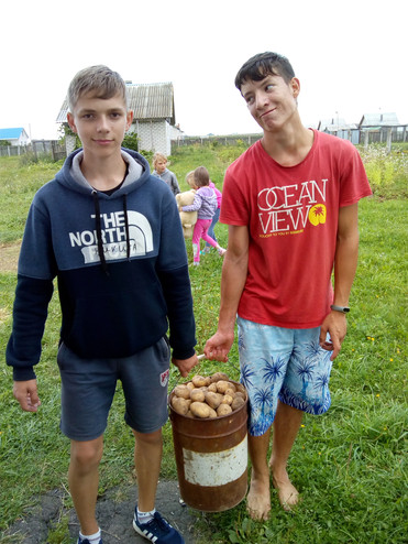 Helping with meal prep at an Evangelistic outreach camp in Belarus village
