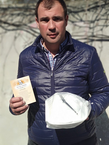 Pastor Dima - head of Barnabas Fund Homeless Feeding with special COVID hot meal and gospel tract