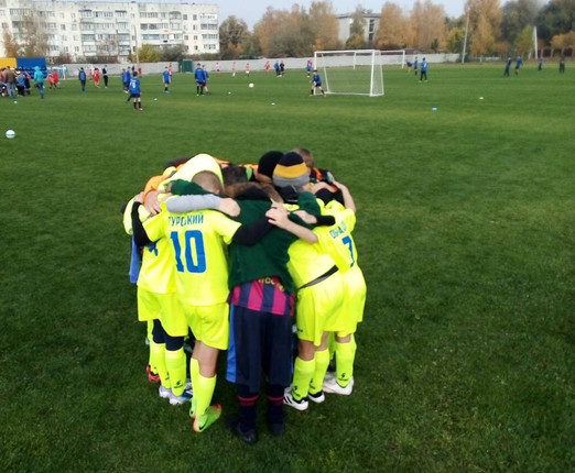 Boys from soccer club huddle up at soccer game