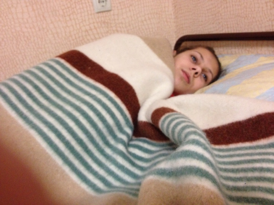 Heavy merino wool blanket given to bed-ridden person in the East