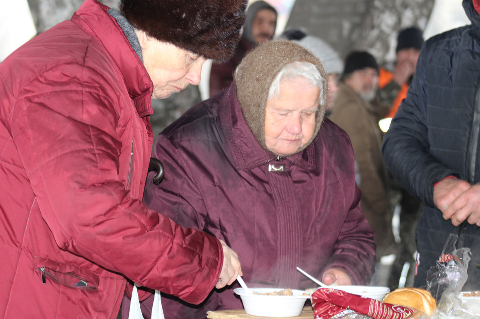 People line up for a hot meal during a typical homeless feeding day