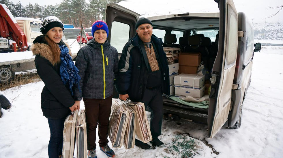 Collecting blankets for distribution to people who are cold in the winter
