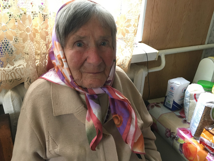 Food pack given to elderly lady in poverty