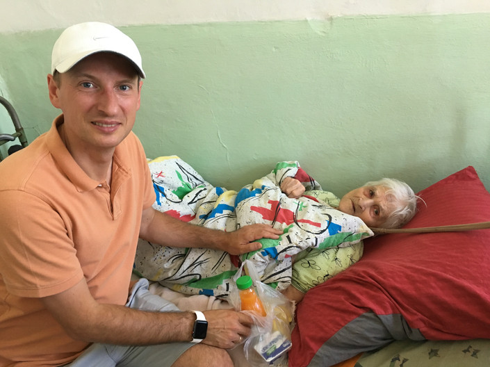 MPI staff member Andrei Shander visits seniors in a home for the ill and bedridden. This home is in very poor condition