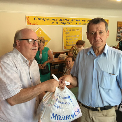 Canadian Pastor Garry Fess from London Ontario vists people and gives out food to church members in Eastern Ukraine with MPI
