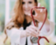 photo-of-woman-holding-red-stethoscope-3