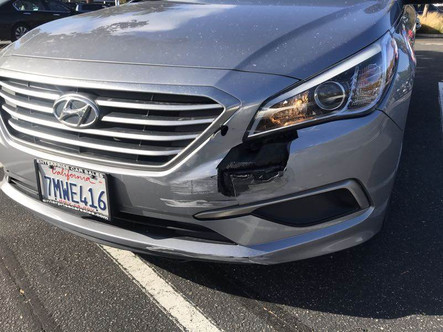Left front damage, close up.