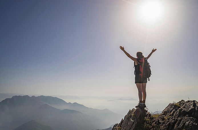 woman-exulting-on-a-mountaintop-buena-vista-images.jpg