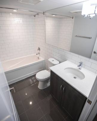 Lit Modern Apartment Bathroom