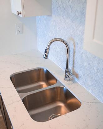 Modern Kitchen Sink with Detailed Blue Backsplash