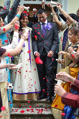 wedding photography bride groom red confetti indian