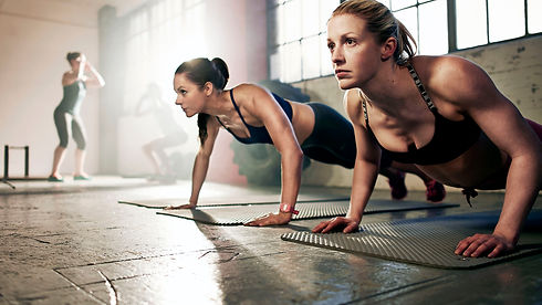 group-of-strong-women-working-out-in-gym