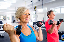 mature-woman-and-senior-man-working-out-