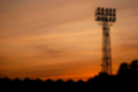 Athletic Field Lights at Sunset