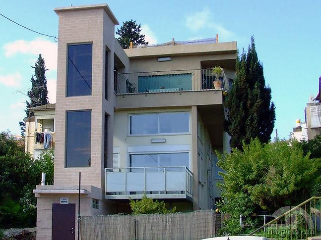 תכנוןתוספת קומה ובניית מעלית בחזית בחיפה