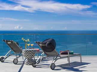 02-Malaiwana Villa R - Deck chairs and v
