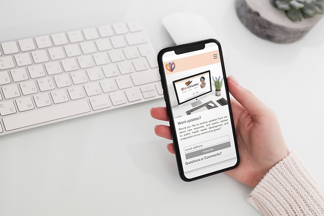 mockup-featuring-a-woman-s-hand-holding-an-iphone-11-pro-over-a-neat-desk-2158-el1.png