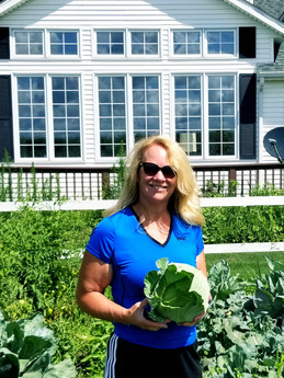 FFA Instructor Diane Morgan in the Community Gardens at The Good Acres