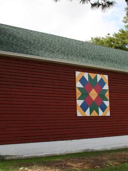 """A Farmer's Daughter"" barn quilt on the corn crib"