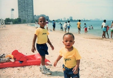 On the beach with my brother as a child.