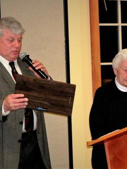 Bob Arndt hands Nancy her Rock County Ag Hall of Fame Award in 2011