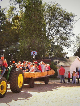 Jim Hodge gives the preschool children a hay ride